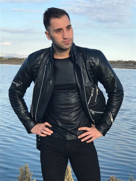 Man wearing wet look PU spandex shirt with leather jacket
